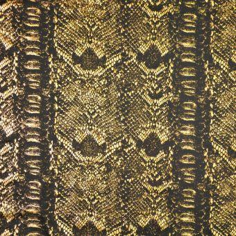 Tissu jersey stretch brillant peau de serpent or