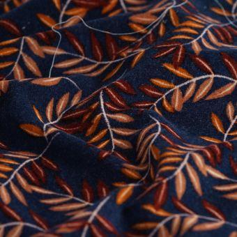 Tissu velours feuillage sur fond bleu marine