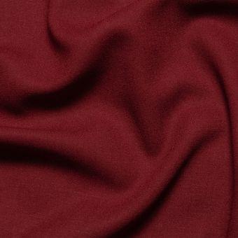 Tissu crêpe de laine Burgundy uni fait en Italie