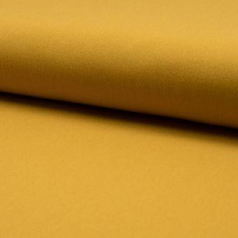 Tissu lainage fin extensible uni jaune ocre