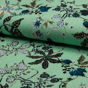 Tissu crêpe viscose brillant  vert menthe à motifs fleurs
