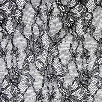 Tissu dentelle de Calais léger noir polyamide motifs arabesques fleuries