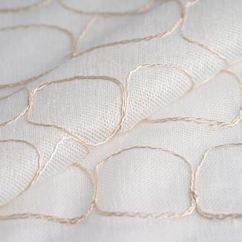 Tissu voilage ivoire brodé de cercles abstraits