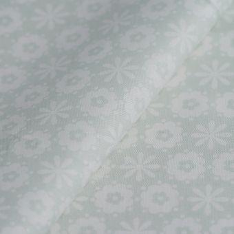 Tissu popeline coton flocons blancs vert