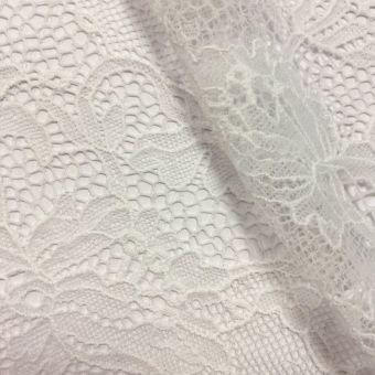 Tissu dentelle de Calais léger blanc polyamide motifs arabesques fleuries