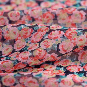 Tissu voile plumetis polyester fleurs roses