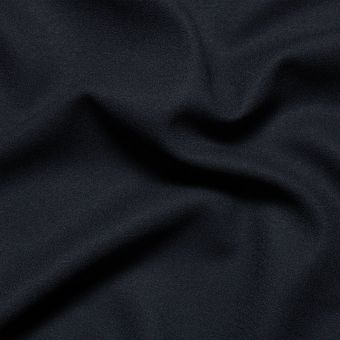 Tissu crêpe de laine bleu marine uni fait en Italie