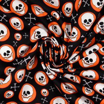 Tissu popeline de coton tête de mort souriant orange
