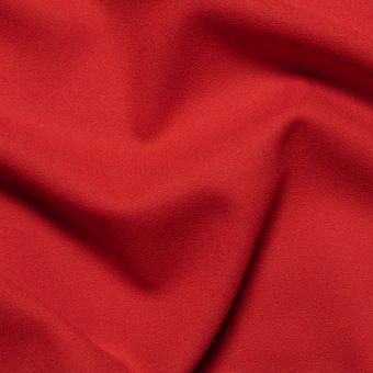 Tissu crêpe de laine rouge vif uni fait en Italie