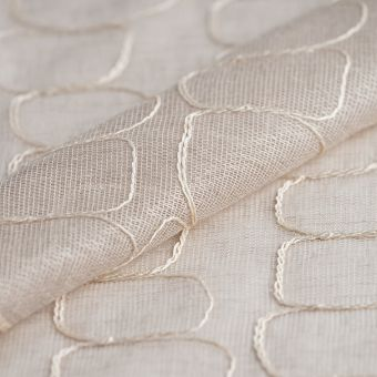 Tissu voilage beige brodé de cercles abstraits