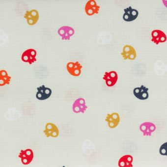 Tissu popeline de coton écru petites têtes de mort colorées