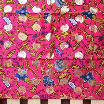 Tissu wax doré motifs fleur tropicale fuchsia