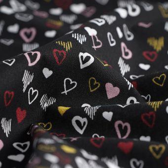 Tissu cretonne noire cœurs