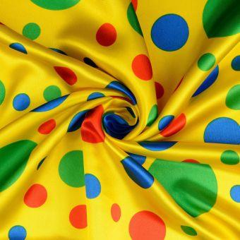 Tissu satin carnaval à pois jaune