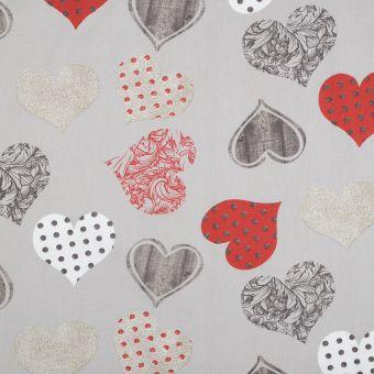 Tissu coton enduit cœurs rouge