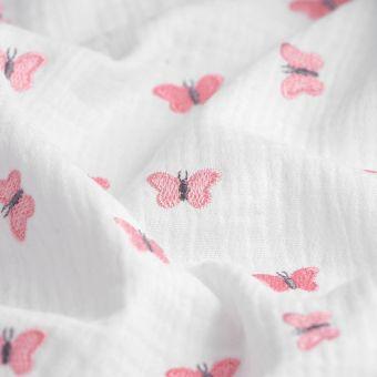 Tissu double gaze broderie papillons rose