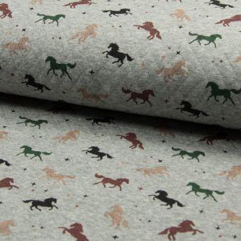 Tissu jersey matelassé coton à motifs chevaux multicolores