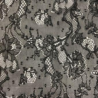 Tissu dentelle de Calais polyamide noir léger à motifs pois et roses sur tiges