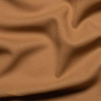 Tissu crêpe de laine camel uni fait en Italie